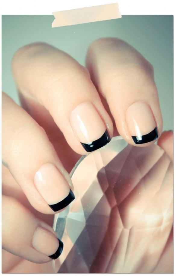Nude manicure with black tips.