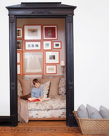 Take the door off of a closet, add molding around the doorway, and put in some comfy seating and pillows. A very unique reading nook!  SO COOL!
