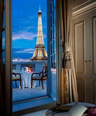 Paris.it would be simply amazing to have this view out your bedroom.
