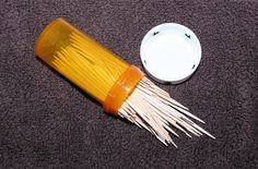 Use a prescription bottle to hold toothpicks. Place in your purse or car for when you are on the go.