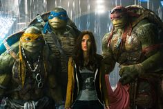 "Animated characters and actress Megan Fox as April, center, appear in the movie ""Teenage Mutant Ninja Turtles."" Action packed and silly, the latest adoption of the comic book characters is still an enjoyable thrill ride for the family #MovieReview"