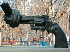 "From the photogrpaher: ""This is a shot of the sculpture outside the UN headquarters in New York. Created by the Swedish artist Carl Fredrik Reutersward as a tribute to John Lennon.  Im pleased with this picture as it makes the gun seem much larger than it really is and emphasises its' detail. Its about 14 inches in length."""