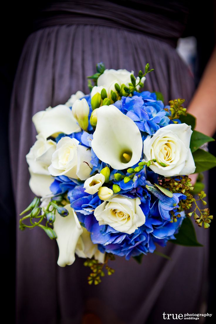 white and blue wedding flowers on bouquets were made of beautiful white roses, white freesias, white ...