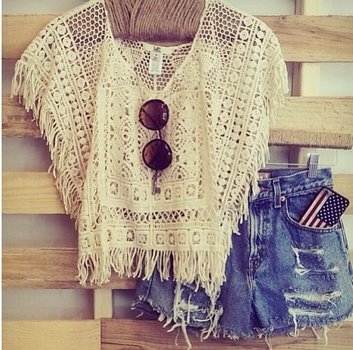 Beachy high wasted shorts with a netted white blouse