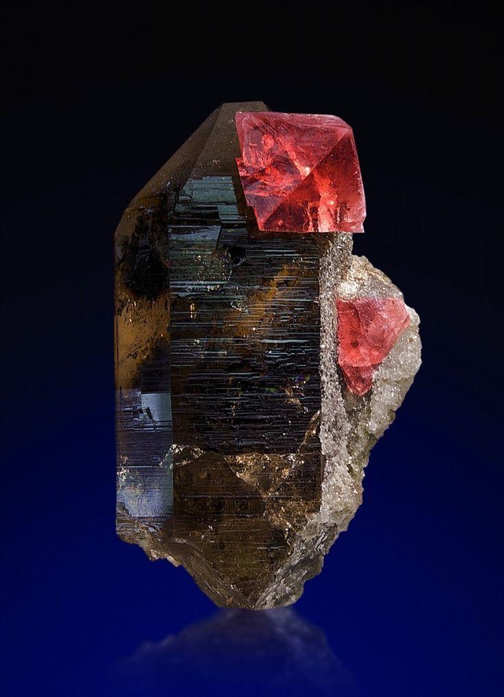 fluorite octahedron on smoky quartz