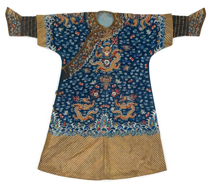 A Chinese blue-ground embroidered silk dragon robe, jifu, late Qing dynasty