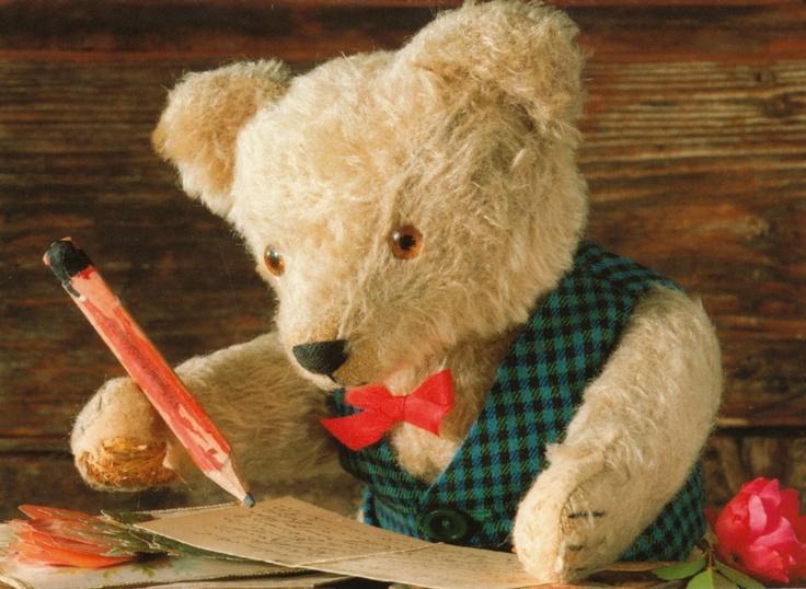 stuffed teddy bear writing a letter