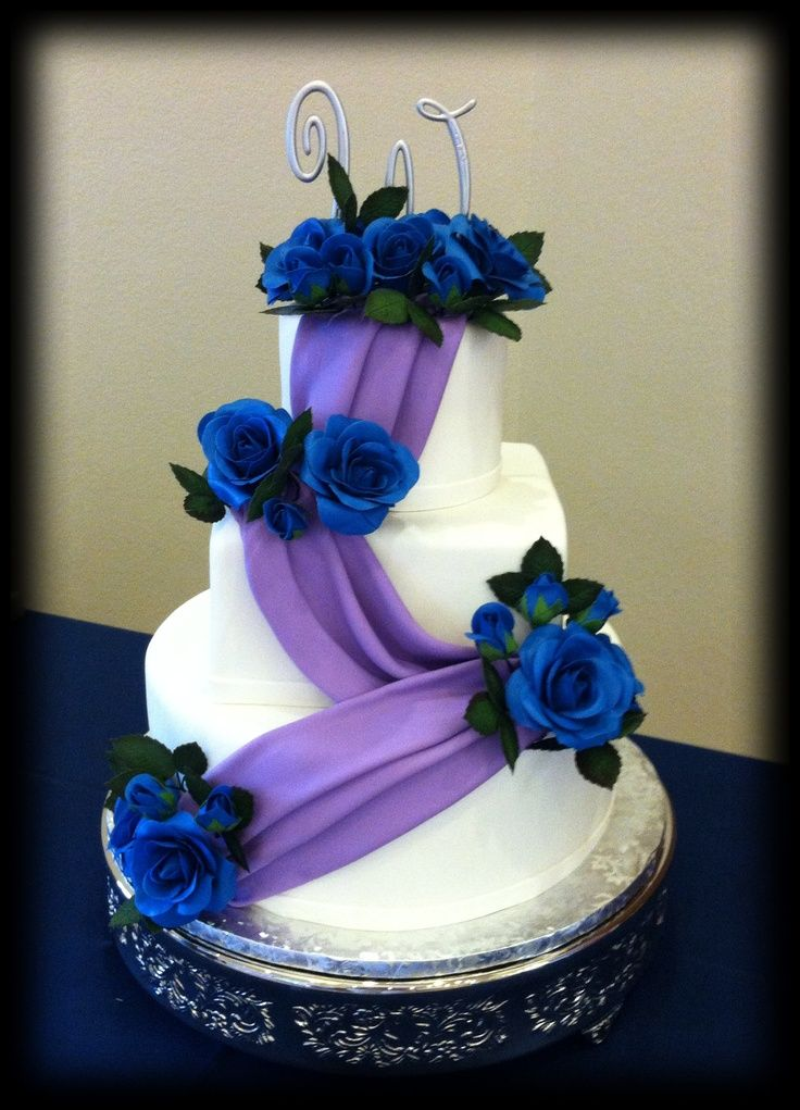 purple and blue wedding cakes | purple swag with blue sugar roses wedding cake | Magalys weeding