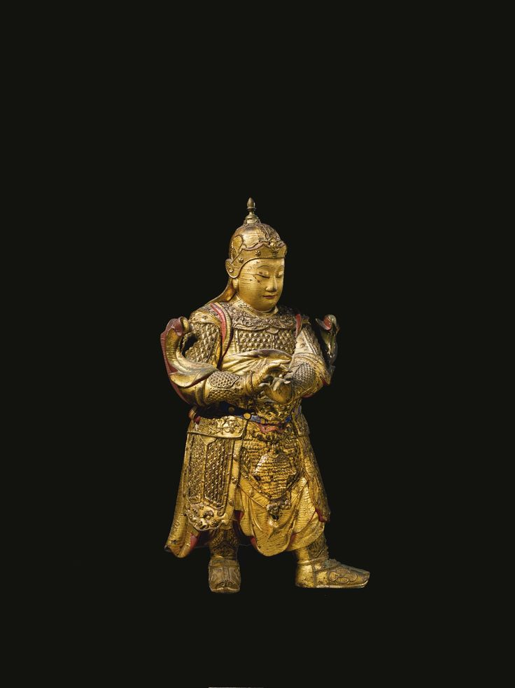A large gilt-lacquered wood figure of Weituo, China, Ming dynasty, 17th century