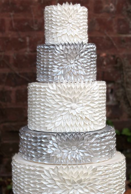 Brides.com: 34 Stunning Wedding Cakes for a Winter Wedding. A Five-Tier Silver and White Wedding Cake. The petal detailing on this Sweet Element Cakes creation softens the metallic silver of two of the tiers. The cake as a whole is a glam show-stopper for a chic uptown wedding in the heart of winter.  See more silver wedding cakes.