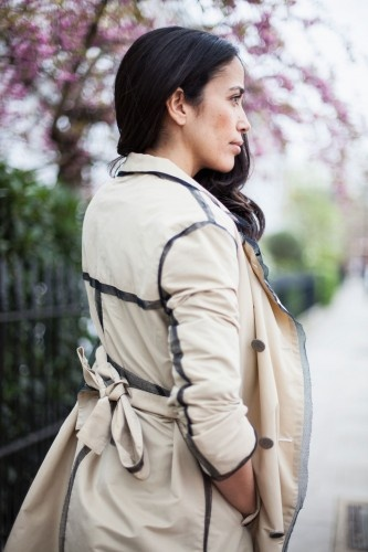 Love the piping on her trench coat. Photos by Eva K. Salvi