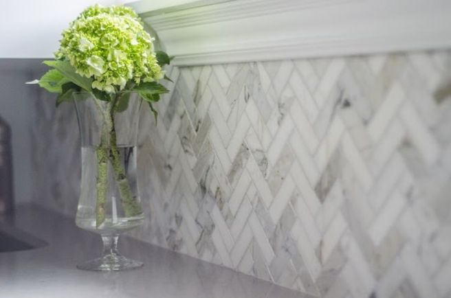 Calcutta marble herringbone backsplash