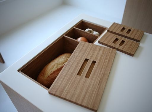 Install in-counter storage for your fruits, bread, and vegetables.