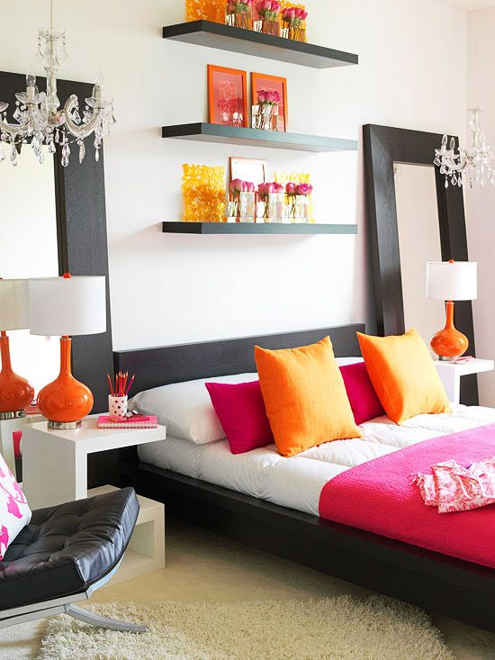 I want to to transform my girls bedroom to this!!!  ORANGE:  Colorful Modern  Tangerine and hot pink combine to give this bedroom an energetic vibe. Black and white are a neutral foundation for the bold color combo, and double mirrors multiply the light throughout the room.