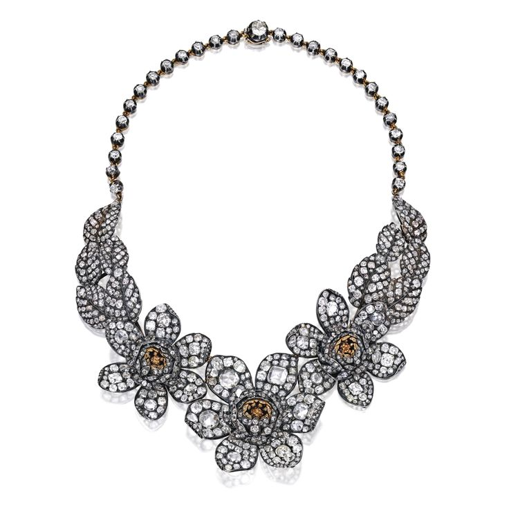 Silver, gold and diamond necklace