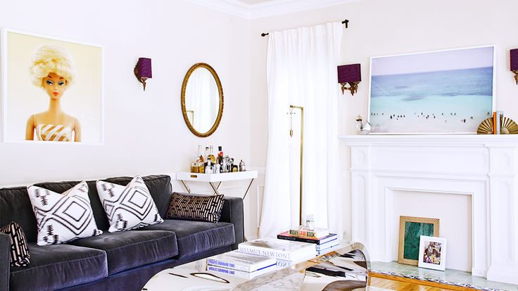 Mantle Makeover: How To Give Your Hearth a New Look  // blue velvet sofa, beach photograph, Barbie art, fireplace