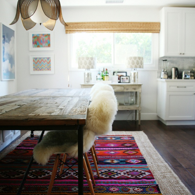 Turkish rug layered over sisal, dining space, tulip light pendant