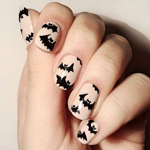 "We've gone batty for this festive Halloween look! Do it yourself with ""My Vampire Is Buff,"" ""Black Onyx,"" and a nail art brush!"