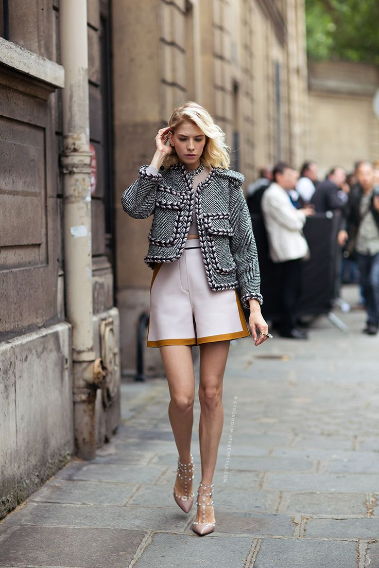 Elena Perminova in VALENTINO studded heels, herringbone tweed jacket, and colorblock shorts.
