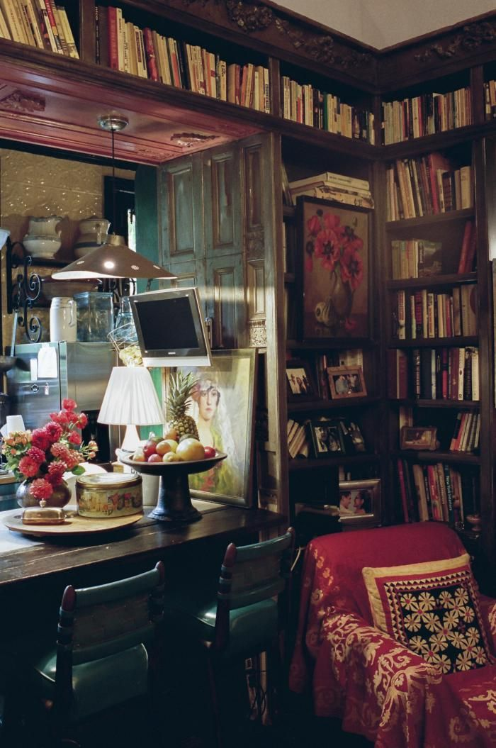 Lorraine Kirke created a wraparound bookshelf in the kitchen and dining room using found pieces of old doors. Her Greenwich Village abode.