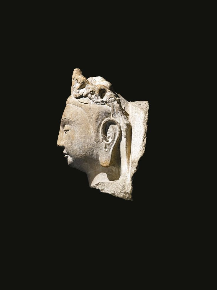 A STONE HEAD OF GUANYIN<br>CHINA, SUI DYNASTY | Lot | Sotheby's