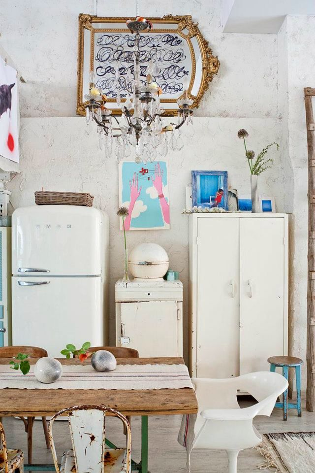 Rustic boho chic kitchen. Vintage wares and Smeg fridge.