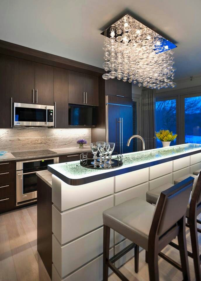 What a gorgeous breakfast bar. Homesandlifestylemedia.com #design #architecture #kitchen