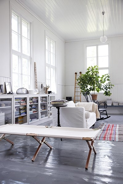 bright, light, white, tall windows, living room, glass book cases, slipcover couch