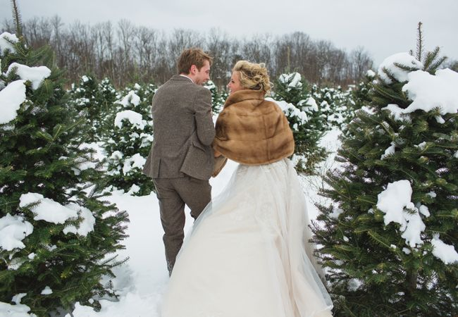 Winter bride & groom portrait ideas // Lauren Fair photography // http://blog.theknot.com/2013/12/16/a-cozy-and-glitzy-winter-wedding/