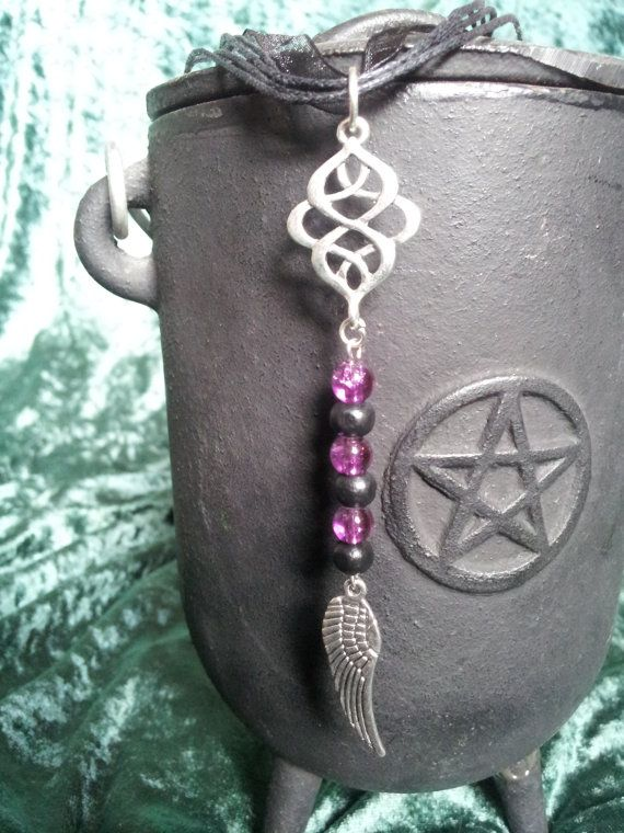 Angel wing necklace, gothic, purple and black, Celtic knot, Pagan, Wicca, Witch. £6.50, via Etsy.