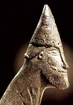 Head of a man carved from an antler