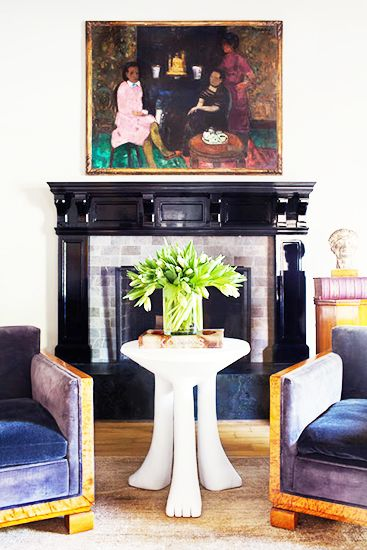 Mantle Makeover: How To Give Your Hearth a New Look // mantle decorating ideas, black fireplace, velvet burl wood armchairs,