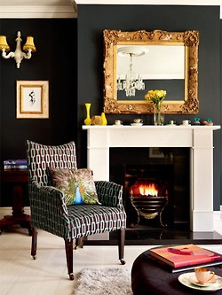 black walls. accent chair. peacock pillow. LOVE