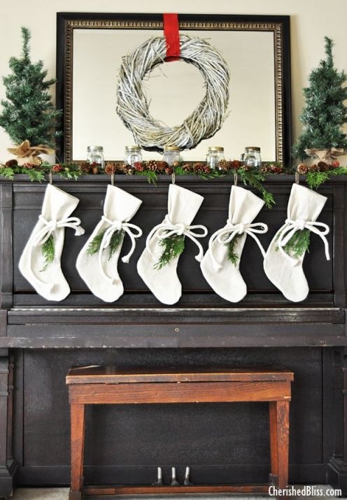 A Rustic Christmas Mantel display on an upright Piano.