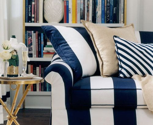 blue and white striped sofa, burlap throw pillow, bookshelves, and a vintage brass bamboo side table | Ralph Lauren