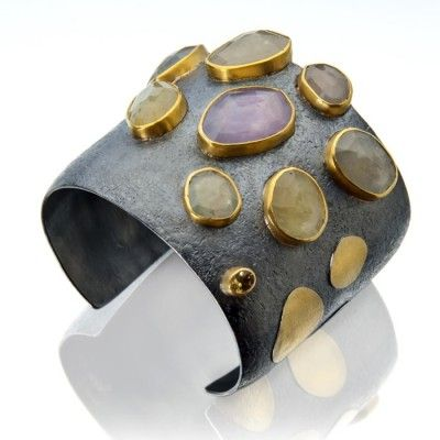Sydney Lynch    Umba sapphire cuff: rose cut pastel sapphires and a golden tourmaline set in 22k gold on oxidized sterling.