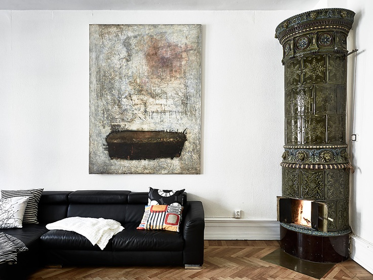 Stadshem. Beautiful! I love the fireplaces in these old Swedish apartments. I also love the art on the wall.