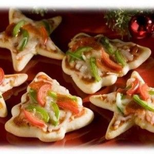 Mini pizza's made with Christmas cookie cutters...