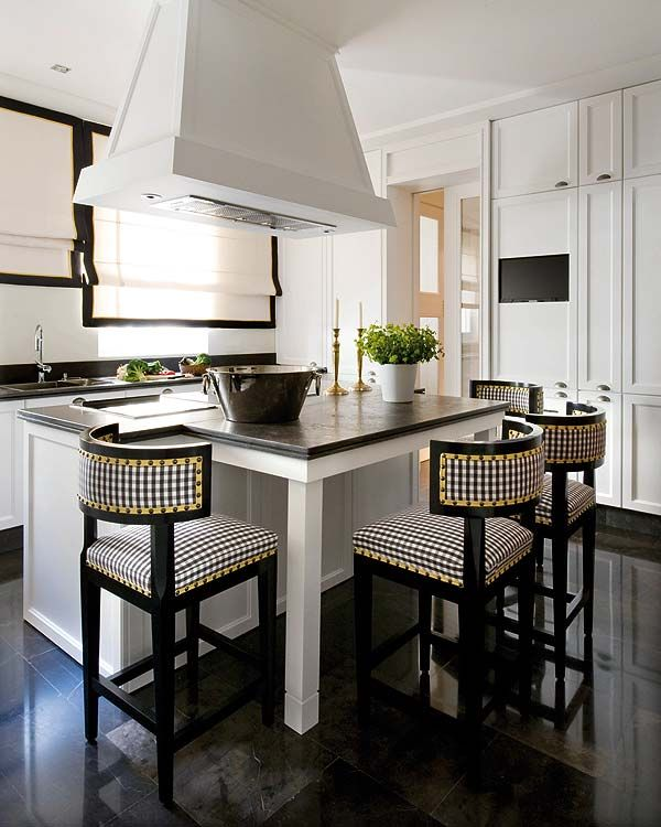 love the nailhead trim on the stools and I LOVE how the island is shaped to fit 4 stools- such a great use of space!!
