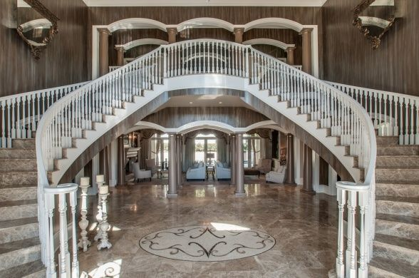 The elaborate foyer features marble flooring and a grand double staircase. See MORE country star homes here>> http://my.gactv.com/at-home/multigallery.esi