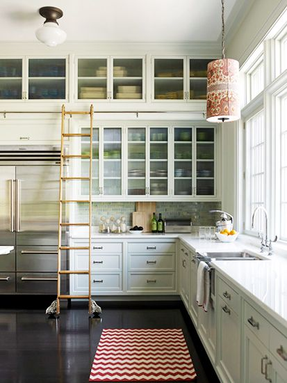 12 best warm neutral paint colors for your walls // neutral white kitchen, library ladder, chevron rug // traditional kitchens
