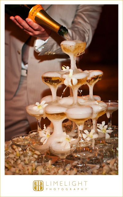 Letting the bubbly flow, literally.  A champange tower to kick off our champagne toast and great decoration.