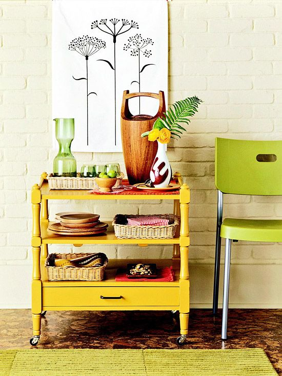 Save money by repurposing old furniture. A paint job and a new set of casters turned this old bedroom shelving unit into a rolling kitchen cart. Its shelves are perfect for holding linens and dishes. The drawer, with its updated drawer pull, can stash takeout menus ( Courtesy of BHG)