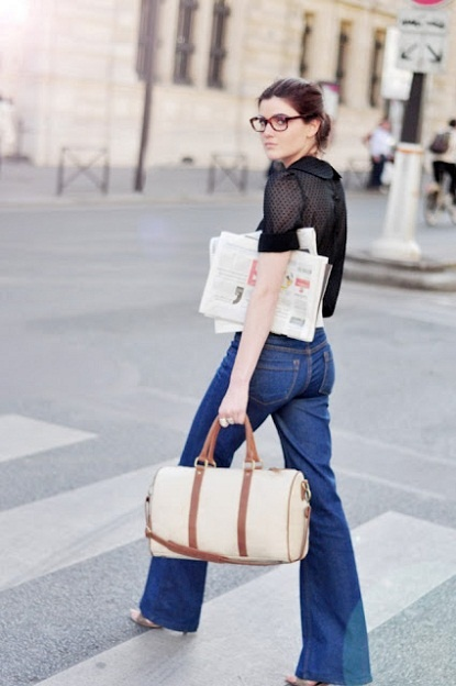 black shirt + trouser jeans + linen duffel bag