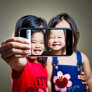 Use Technology: Smartphone Photos     Snap a picture on your smartphone. Then, with your digital camera, take a photo of your kids holding it.