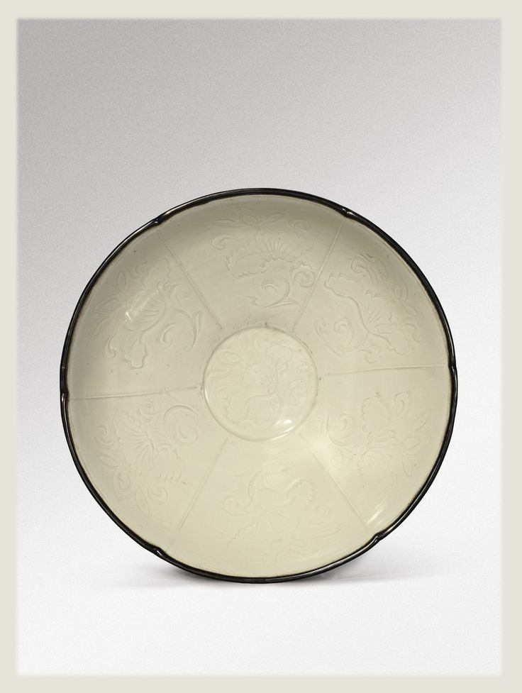 A carved 'Ding' 'Lotus' bowl, Northern Song Dynasty
