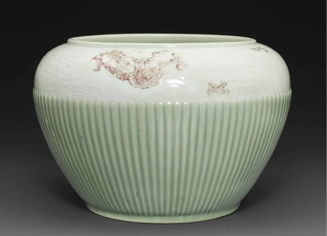 A rare copper-red-decorated and celadon-glazed 'Hundred Rib' jar,guan, Kangxi period (1662-1722)