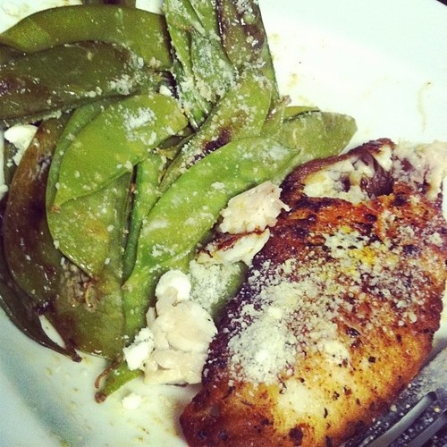 Blackened tilapia and sautéed snow peas with 1tsp of Parmesan :) 4oz tilapia, 8 oz snow peas! Grill the blackened tilapia, or pan fry, and sautee the snow peas in a tiny bit of olive oil and I can't believe it's not butter spay. I added garlic and onion to taste(just a lil bit) this whole meal, 249 calories:)