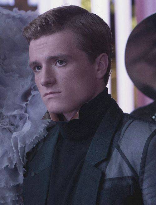 Peeta in 'Catching Fire' | It kills me. In every picture from Catching Fire Peeta, at a glance, looks normal. Not overly happy just average. But when you look closely, you find he's not. He looks sad. He's putting on a front, but he can't completely hide the deep sadness he has at the end of the day.
