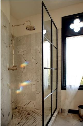 This shower uses an old factory window for the partition. Wonder how hard that would be to find/DIY?